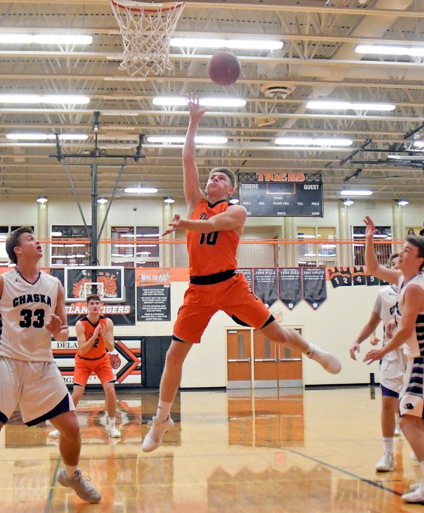AIR CALVIN Calvin Wishart find his inner airness and floats to the rim for two points in the first half of Tuesday's home game against Chaska. Wishart scored 43 points and had a triple-double, but the Tigers came up short in an 84-8-3 loss to the Hawks. Photo by Matt Kane