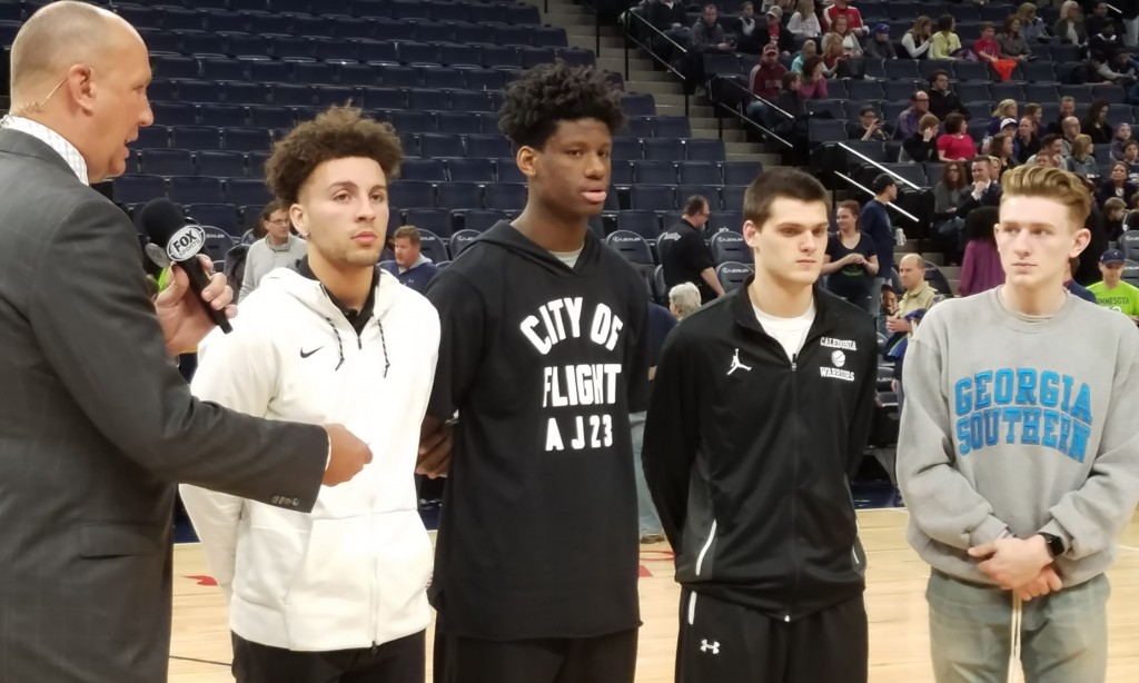 Calvin Wishart (far right) stands with fellow Mr. Minnesota Basketball finalists Gabe Kalscheur (players, from left) Daniel Oturu and Owen King during an interview with 1980 Mr. Basketball Jim Petersen as part of the Timberwolves postgame show Wednesday night. Photo by Matt Kane