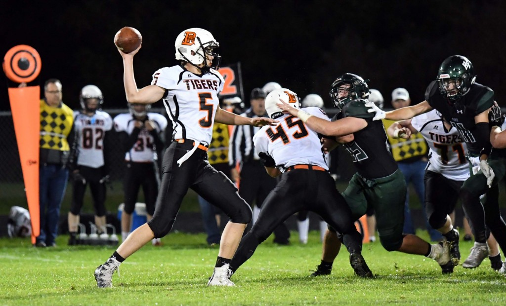 Max Otto threw for three touchdowns Sept. 21 in Delano's 31-28 win at Holy Family. Photo by Matt Kane