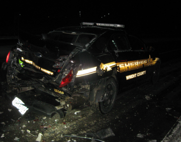 This Wright County Sheriff's Office squad car was struck while stopped on the shoulder of Highway 12 Sunday evening.