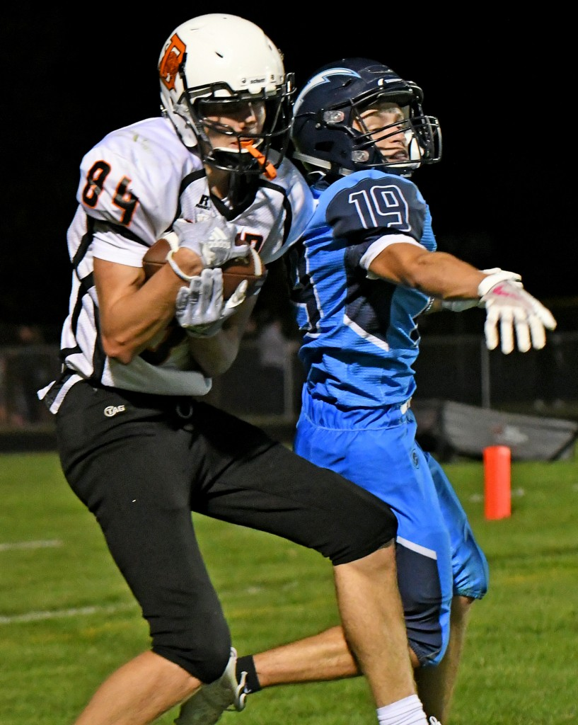 Delano's Trey Longstreet secures the football for a touchdown catch over Zimmerman's Kyle Briggs in the third quarter of Thursday's game at Zimmerman. Longstreet caught two touchdown passes, but it wasn't enough, as five turnovers cost the Tigers in a 37-19 loss. Photo by Matt Kane