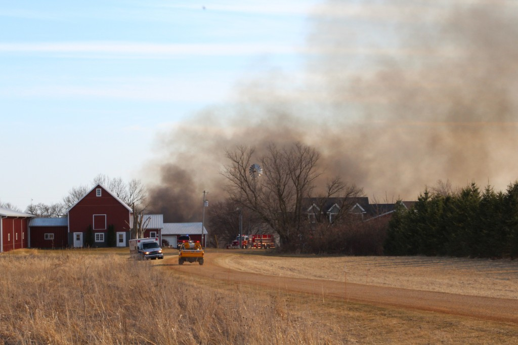 Smoke billows from a Tuesday evening swamp fire behind the residence at 1495 110th St. SE between Watertown and Delano.