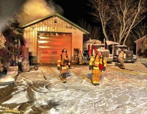 Firefighters battle a blaze in a shed at 4035 85th St. SE in Franklin Township. (Photo by Joe McDonald)