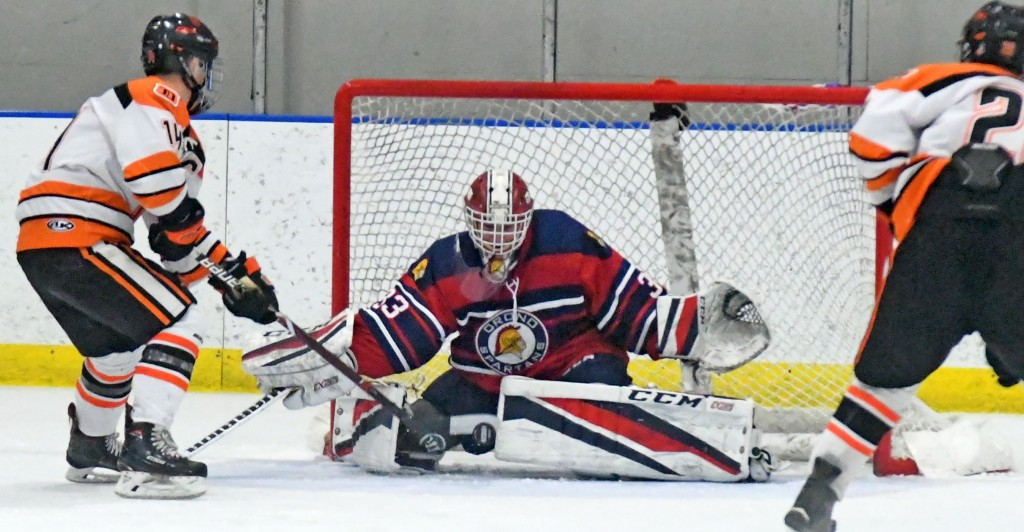Orono goalie Evan Babekuhl denies Delano's Justin Daly on a quality chance in the third period. Orono want on two win the 3-2 in overtime. Photo by Matt Kane