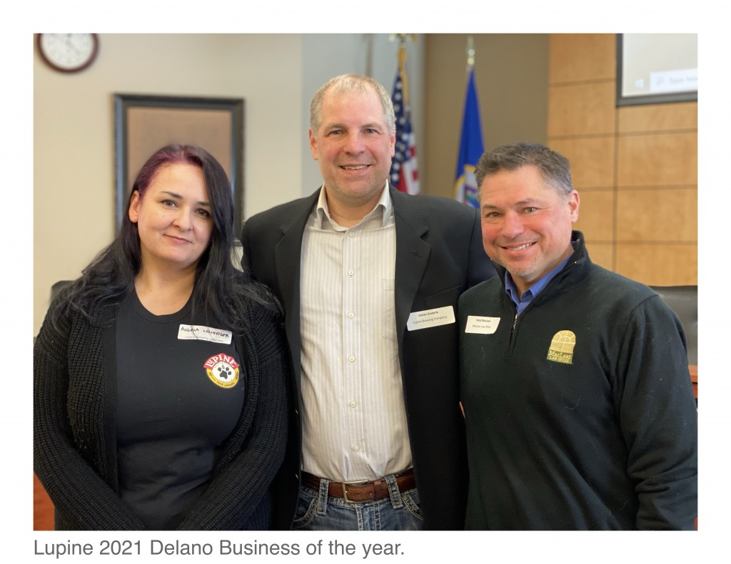 DACC President Daryl MacLean (right) congratulates Lupine Taproom Manager Angela  Loscheider and Owner James Anderle. (Photo by Joe McDonald)