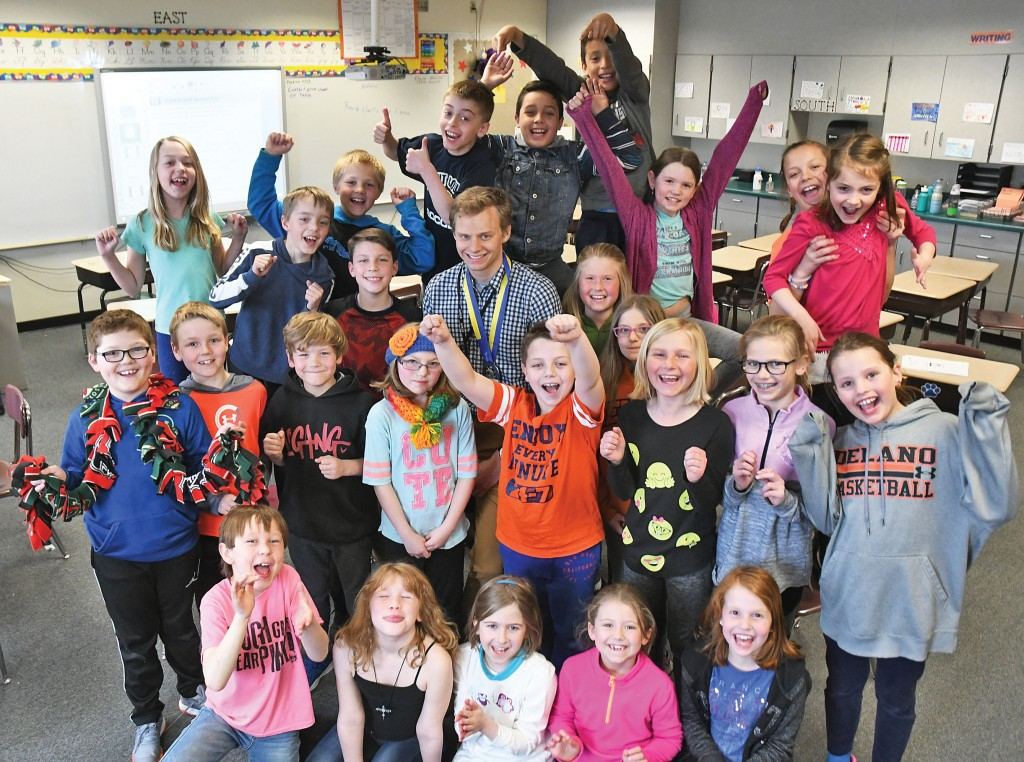 His third-graders at Delano Elementary School were happy to have Jackson Lindquist back in class Wednesday, two days after he finished 77th at the Boston Marathon. The students tracked Lindquist's progress in Boston on the classroom SMART Board. Photo by Matt Kane