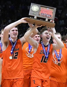 Keegan O'Neill and Calvin Wishart rush the state championship trophy toward the student section with their teammates Saturday after winning the Class AAA title over Columbia Heights. Photo by Matt Kane
