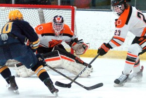 Delano goalie Jackson Hjelle and defenseman Tanner Glasrud defend a Breck attack during the Section 2A title game last season. Both Tigers will be on the ice Friday night, when Delano hosts Breck in a regular-season meeting. Photo by Matt Kane