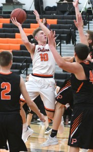 Even triple-team defense didn't work for Princeton against Delano's Calvin Wishart Tuesday night. Wishart scored 47 points and had 17 assists for the Tigers. Both are single-game records for Delano. Three days earlier, in a home win over Waseca, Wishart moved on top of the Delano boys career scoring list, taking over the lead from Toby Hanson. Photo by Matt Kane