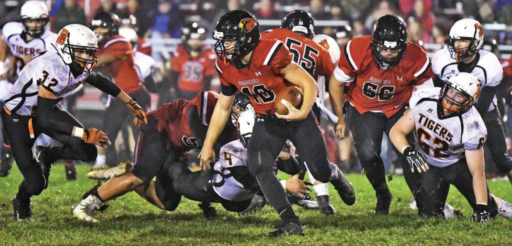 Delano's defense kept Annandale's Peyton Fobbe bottled up pretty well Oct. 5 in the wet game at Annandale, but the Cardinal quarterback did find the end zone twice in the first half. Those two touchdowns proved to be the difference in Annandale's 13-8. Photo by Matt Kane