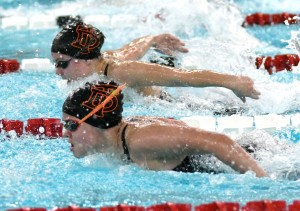 Delano's Emma Kern (foreground) battles teammate Laila Rosenow in the finals heat of the 100 butterfly Saturday at the Section 3A meet in Willmar. Kern won the race and Rosenow finished fourth. Both will swim the event Friday at the state meet. Photo by Matt Kane