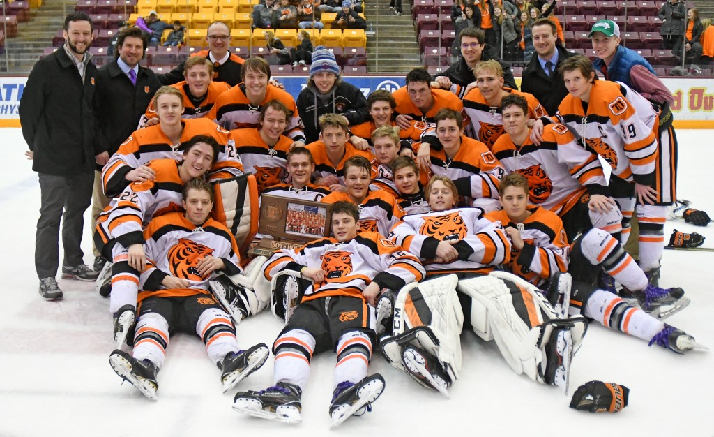 Delano poses with the Class A consolation trophy Saturday morning at Mariucci Arena following a 2-1 win over North Branch. Photo by Matt Kane