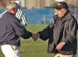 OLD FOES As they did here after a Section 5-4A semifinal game in 2008, Becker's Dwight Lundeen (left) and Delano's Merrill Pavlovich have met at midfield for a postgame handshake many times during the four decades both have coached their respective teams. With a combined 651 wins, the two will shake hands again Saturday following the Section 6-4A semifinal game at Tiger Stadium. Photo by Matt Kane