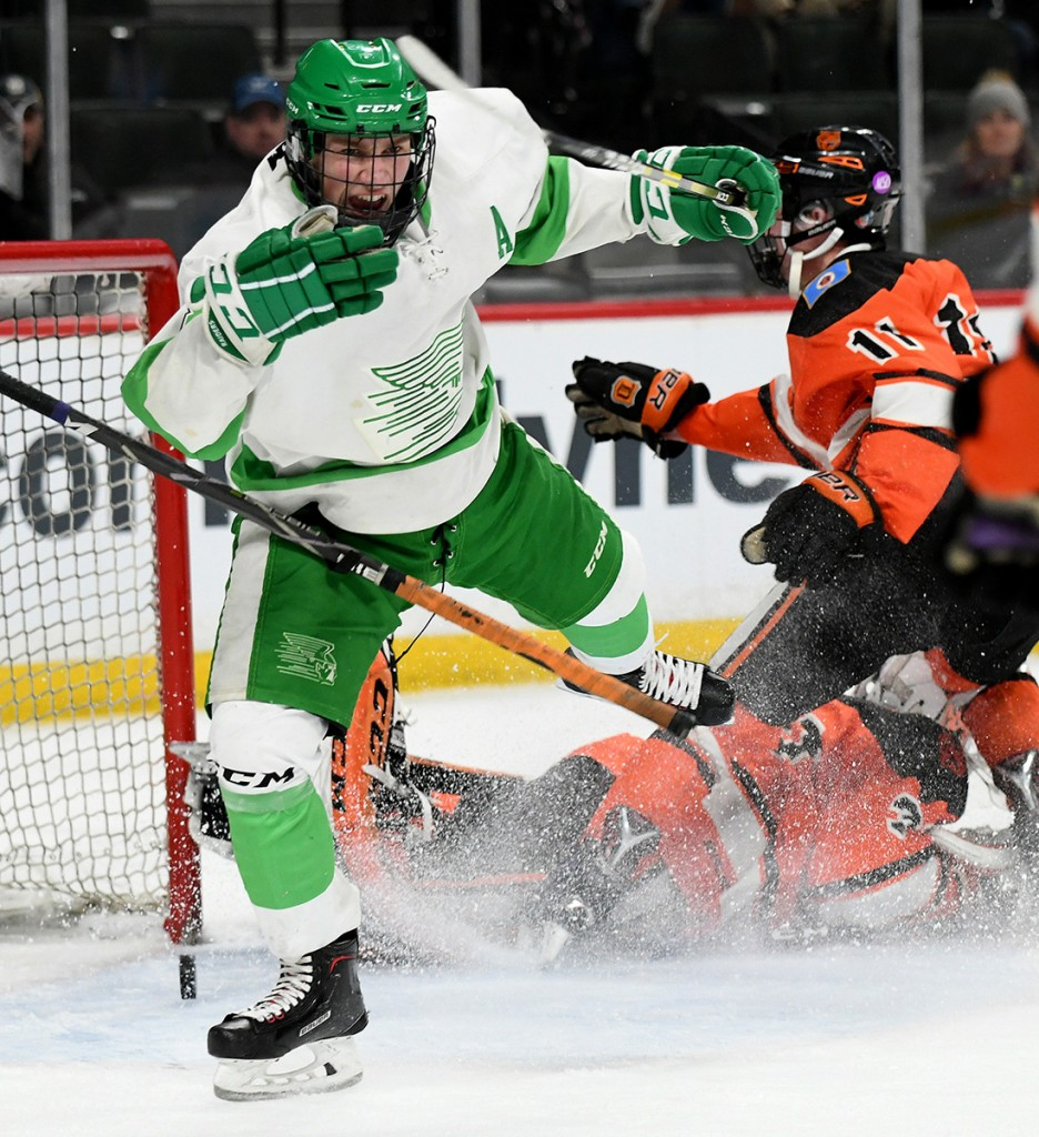 Greenway's Ben Troumbly begins his celebration after tying the game 2-2 in the second period Wednesday night against Delano in the Class A state quarterfinals at the Xcel Energy Center. In a tight game, Greenway knocked off the Tigers 6-4. Photo by Matt Kane