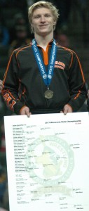 Delano senior Tucker Sjomeling poses with his first-place medal and the bracket after winning the Class AA 132-pound wrestling championship Saturday at the Xcel Energy Center. Photo by Matt Kane