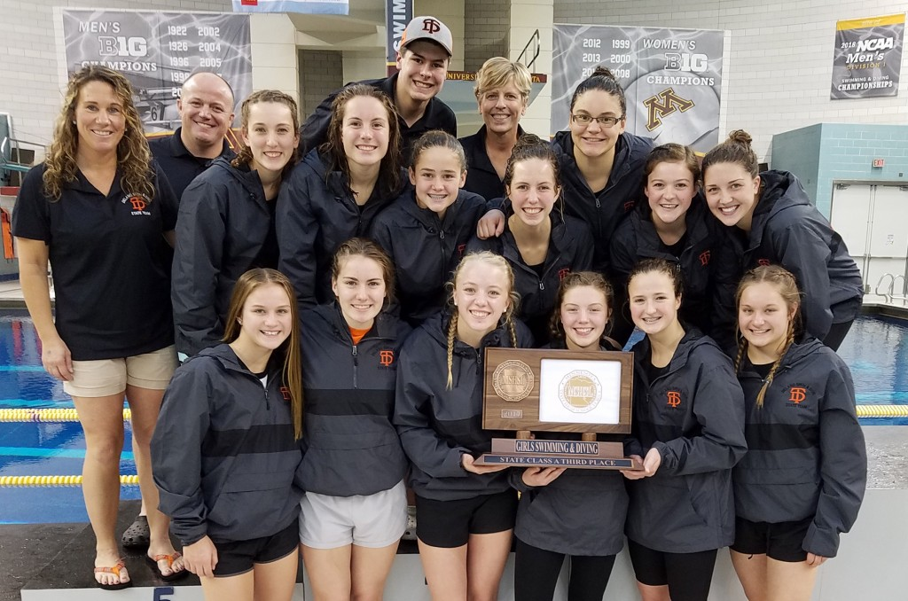 The Delano swimming team poses with their shiny new third-place trophy Saturday afternoon at the UofM Aquatic Center following an impressive day at the Class A state meet. Photo by Matt Kane